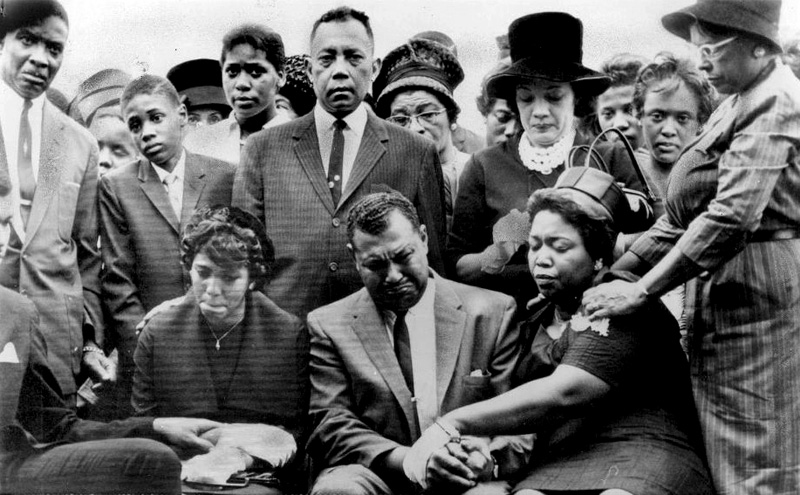 Carole Robertson's family gathered for her graveside service on September 17, 1963 at Shadow Lawn Cemetery. Seated are her sister and parents. AP wirephoto