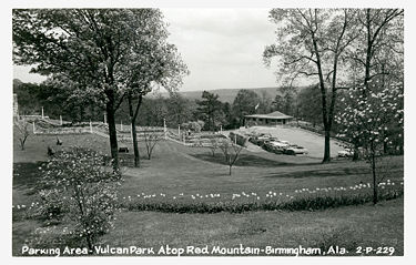Postcard view of the cascade, parking lot and visitor's center, circa 1949