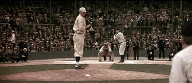 "Still from ""Cobb"", with Roger Clemons on the mound portraying Ed Walsh and Tommie Lee Jones as Ty Cobb, about to steal third."