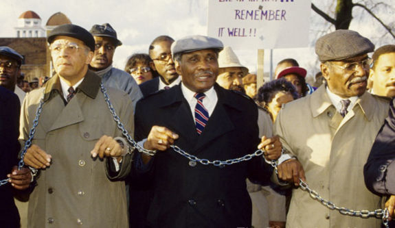 Arrington marches with Abraham Woods and Fred Shuttlesworth on January 24, 1992 to protest his imprisonment on federal contempt of court charges.