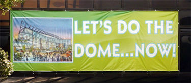 Banners enlisting support for a domed stadium were produced by Mayor Larry Langford's staff and hung downtown in July 2009
