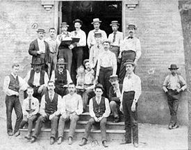 Workers in front of the company's commissary