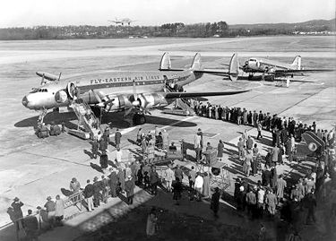 Passengers boarding a Lockheed Constellation operated by Eastern Airlines. Undated photograph by Charles Preston. courtesy BPL Archives