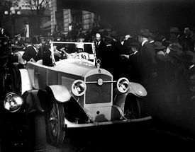 Harding arrives in a Birmingham-built Premocar.