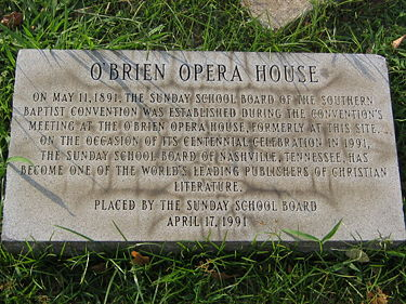 Plaque commemorating the O'Brien Opera House on 1st Avenue and 19th Street North